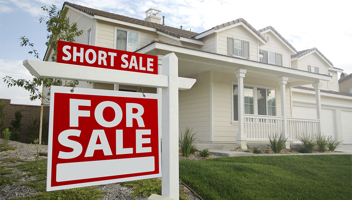 real estate for sale sign selling house short sale article